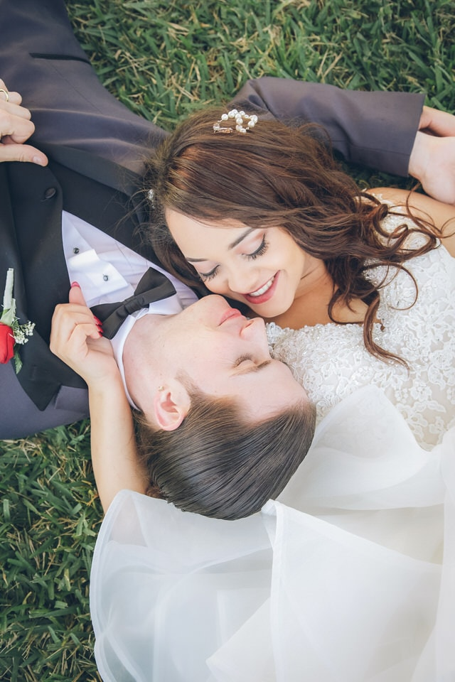 newlyweds laying on the floor opposite of each other, miami wedding photographer portfolio