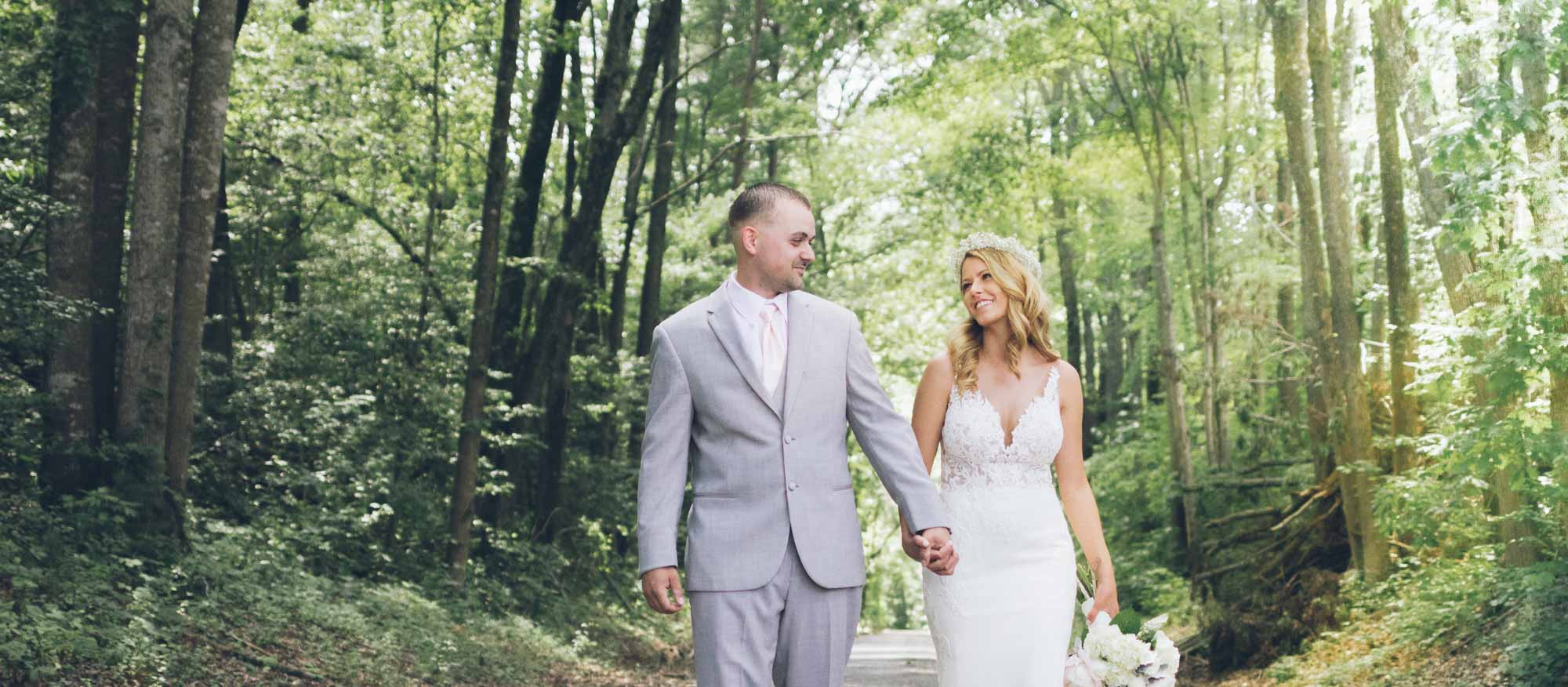 newlyweds walking at a forest preserve, photographed by Eivan's in Richmond