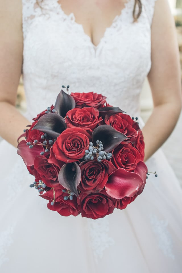 close-up shot of flower on grooms suit, sacramento wedding photographer packages and pricing