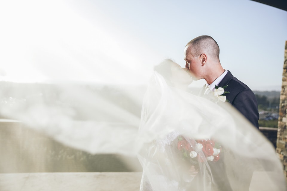 newlyweds kissing, san diego wedding photographer packages and pricing