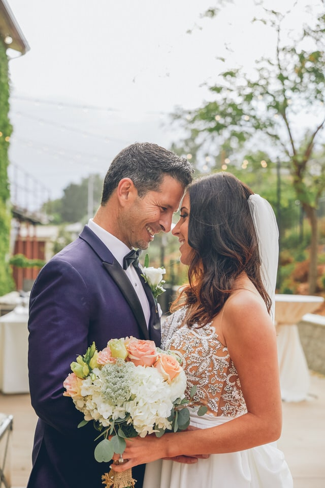 newlyweds about to kiss, san diego wedding photographer availability