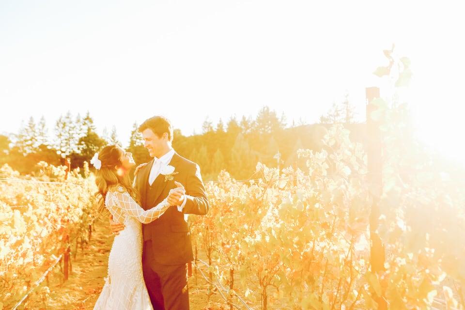 newlyweds dancing in a field of flowers, san francisco wedding photographer portfolio