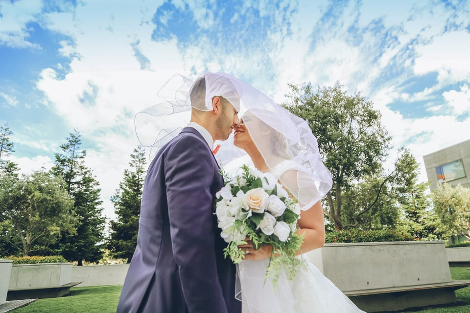 newlyweds kissing, san francisco wedding photographer packages and pricing