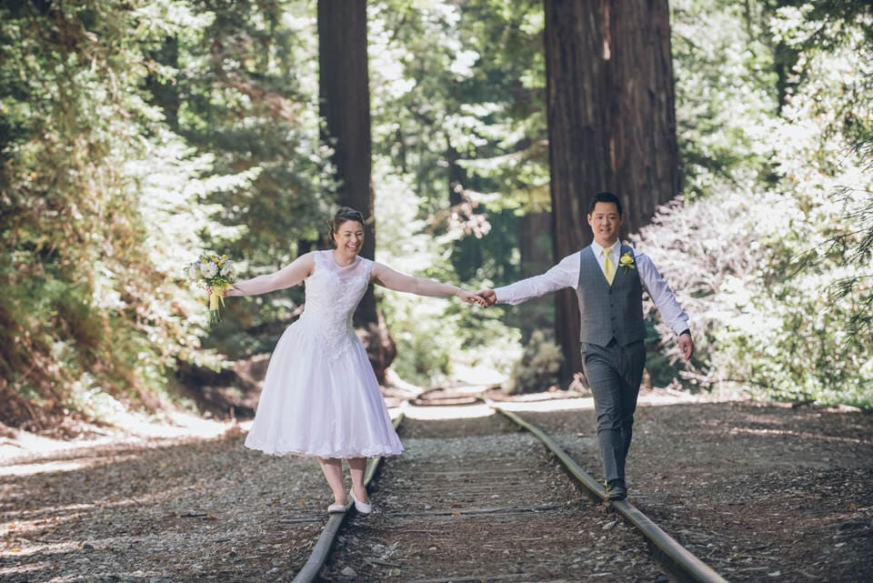 newlyweds walking on the traintrack, san francisco wedding photographer packages and pricing