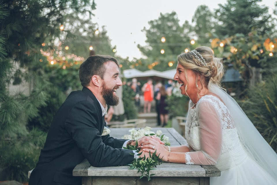 newlyweds sitting across from each other, cleveland wedding photographer portfolio