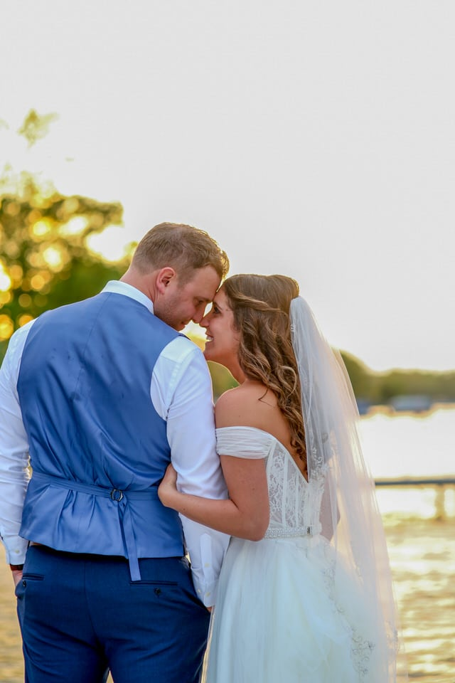 newlyweds looking into each others eyes, grand rapids wedding photographer packages and pricing