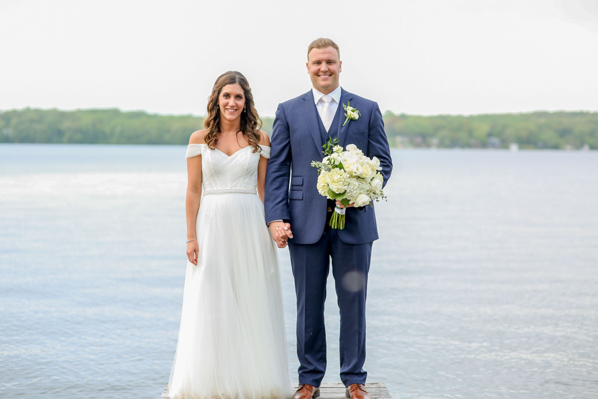 newlyweds posing while holding hands, photographed by Eivan's in Grand Rapids