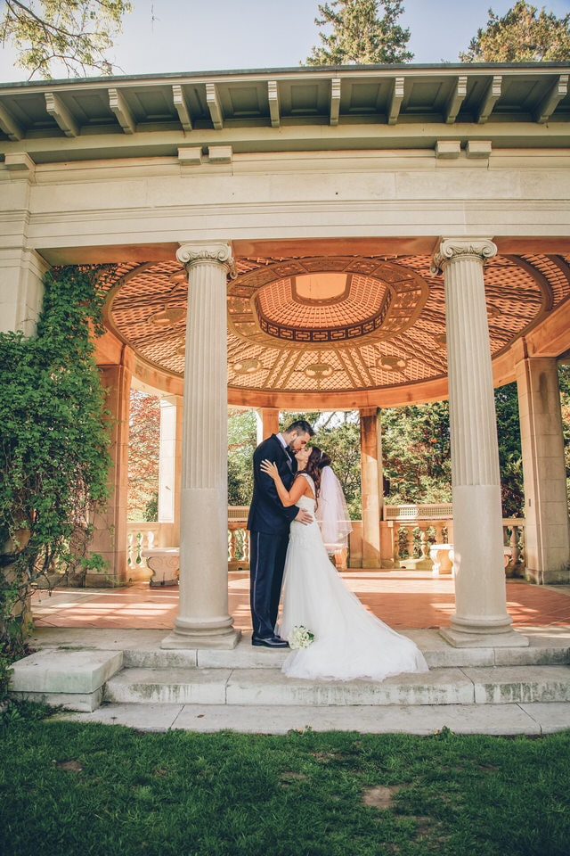 newlyweds kissing under a gazebo, hartford wedding photographer packages and pricing