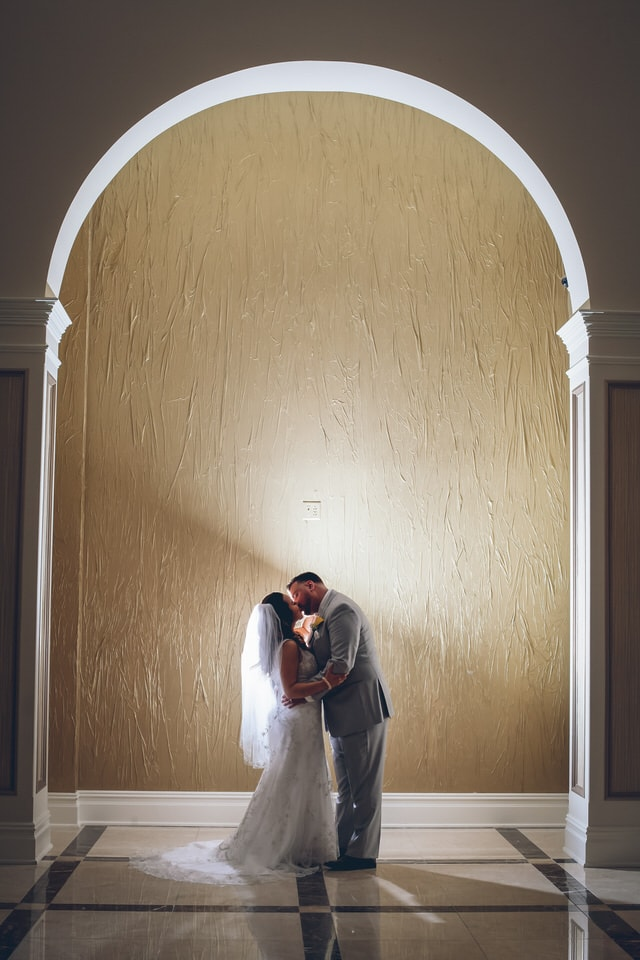 newlyweds kissing in a hallway, hartford wedding photographer portfolio