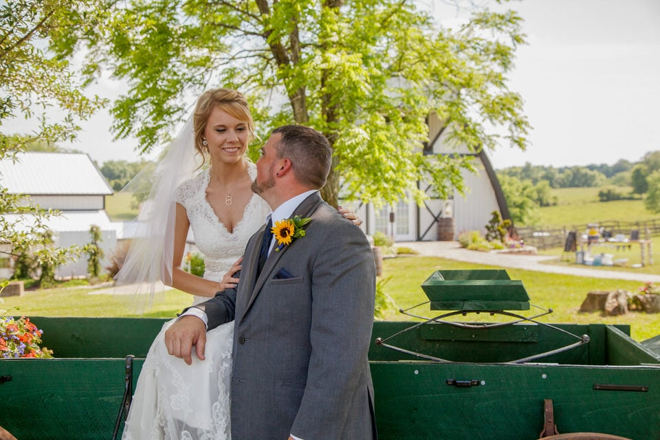 newlyweds sitting on a truck, indianapolis wedding photographer availability