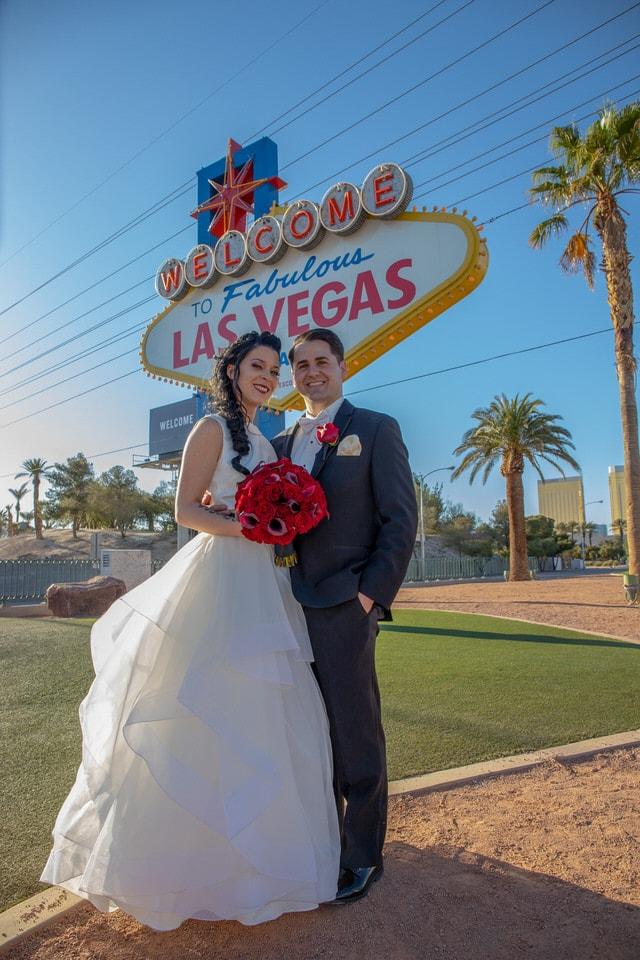newlyweds in front of the las vegas sign, las vegas wedding photographer portfolio