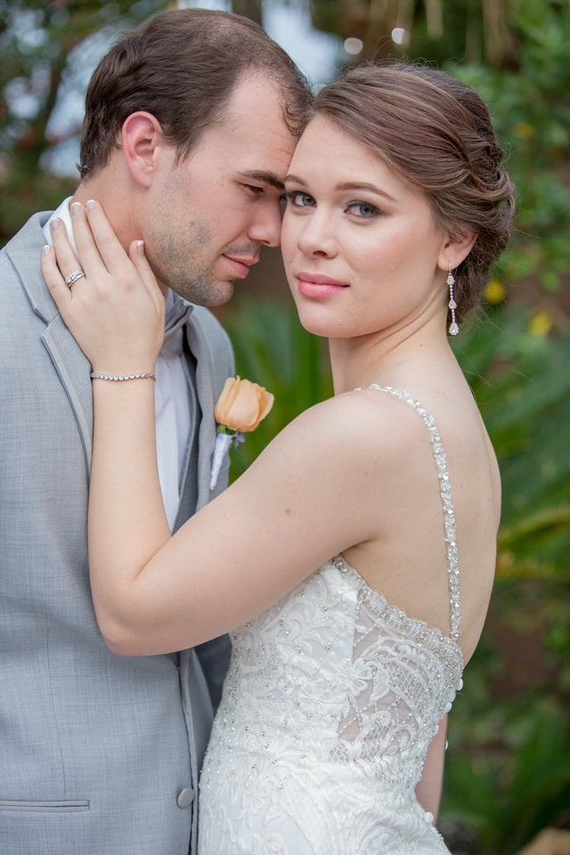 newlyweds sharing a moment, las vegas wedding photographer packages and pricing