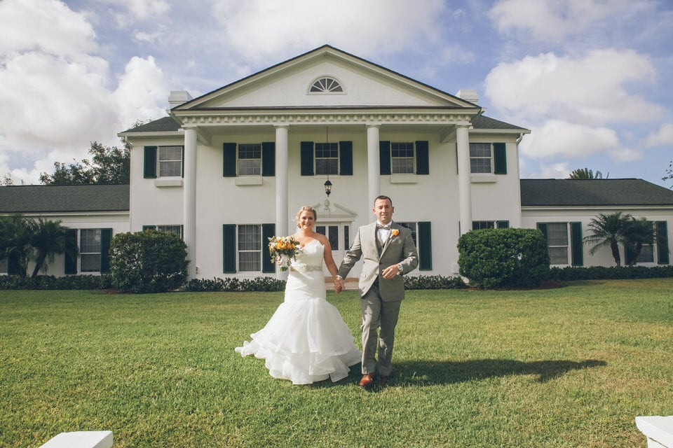 newlyweds in front of their wedding venue, orlando wedding photographer packages and pricing