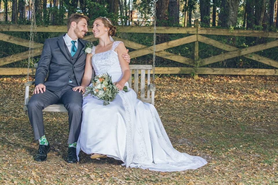 newlyweds sitting on a swing, orlando wedding photographer availibilty