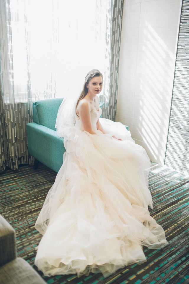 woman in white wedding dress sitting on couch