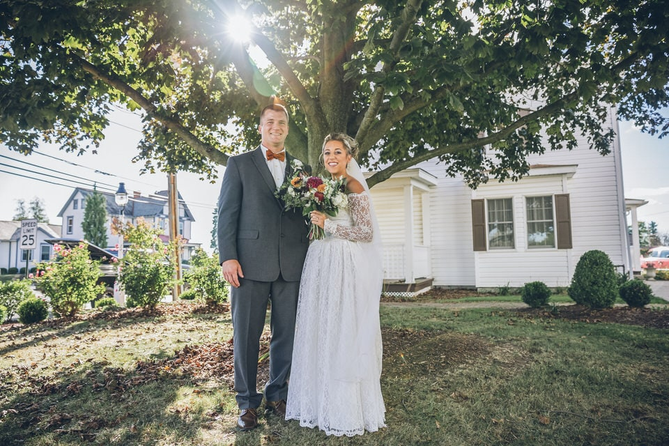 newlyweds in front of a tree, pittsburgh wedding photographer packages and pricing