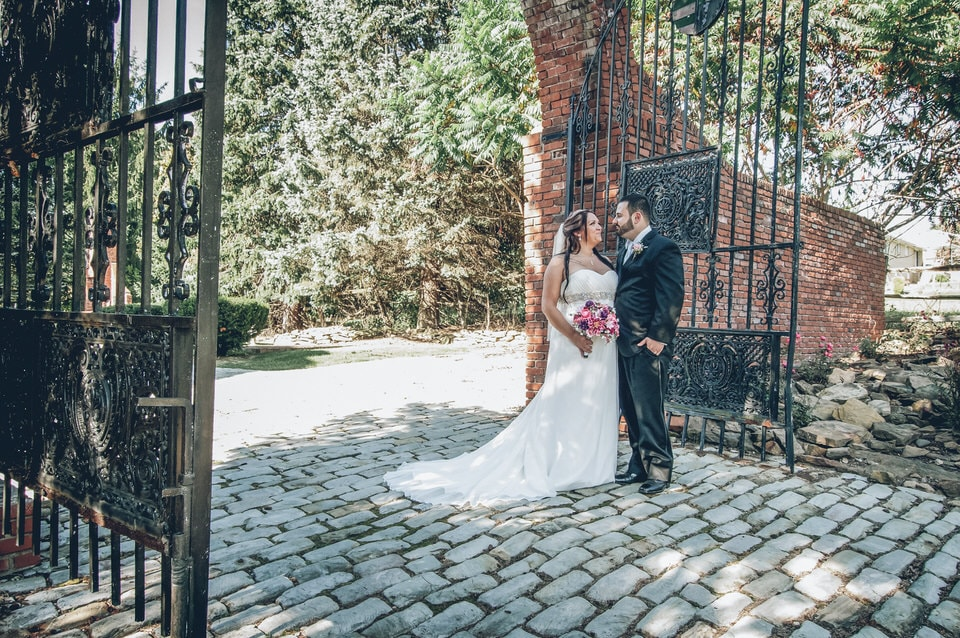 bride and groom standing on gray brick floor during daytime