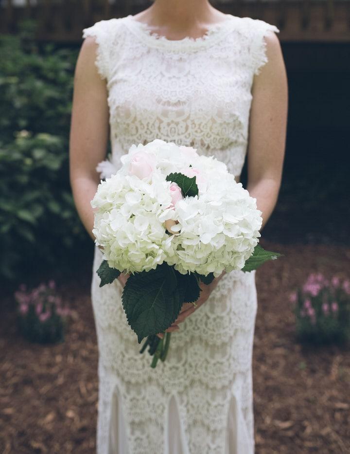 newlywed bride with bouquet, raleigh wedding photographer portfolio