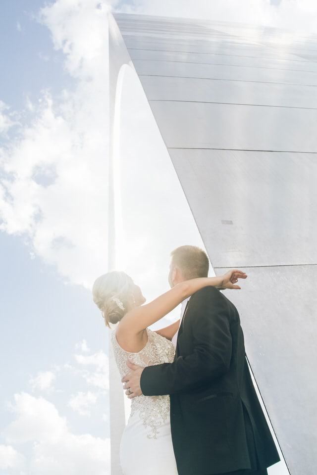 newlyweds sharing a moment, st louis wedding photographer packages and pricing