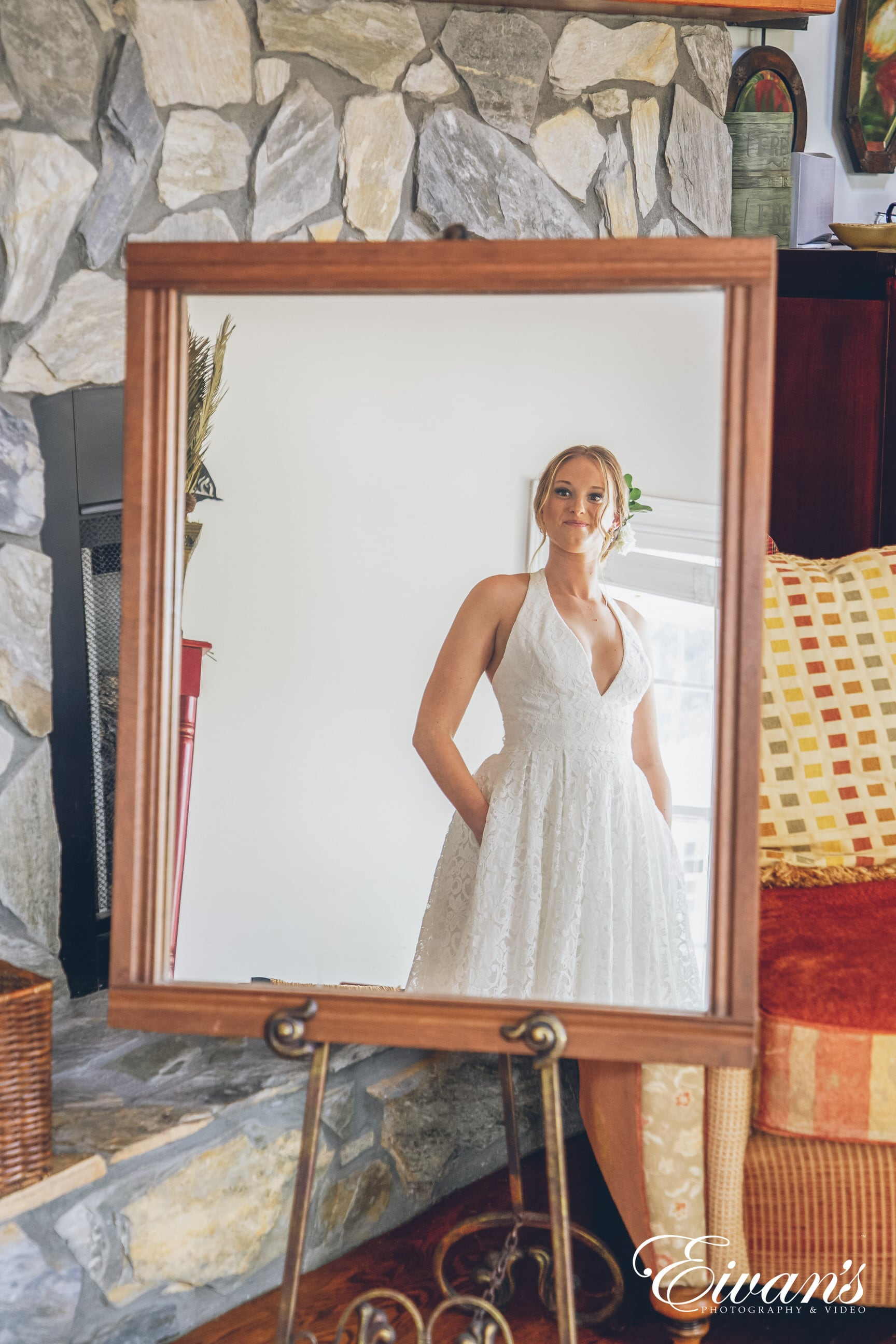 woman in a white dress looking in the mirror
