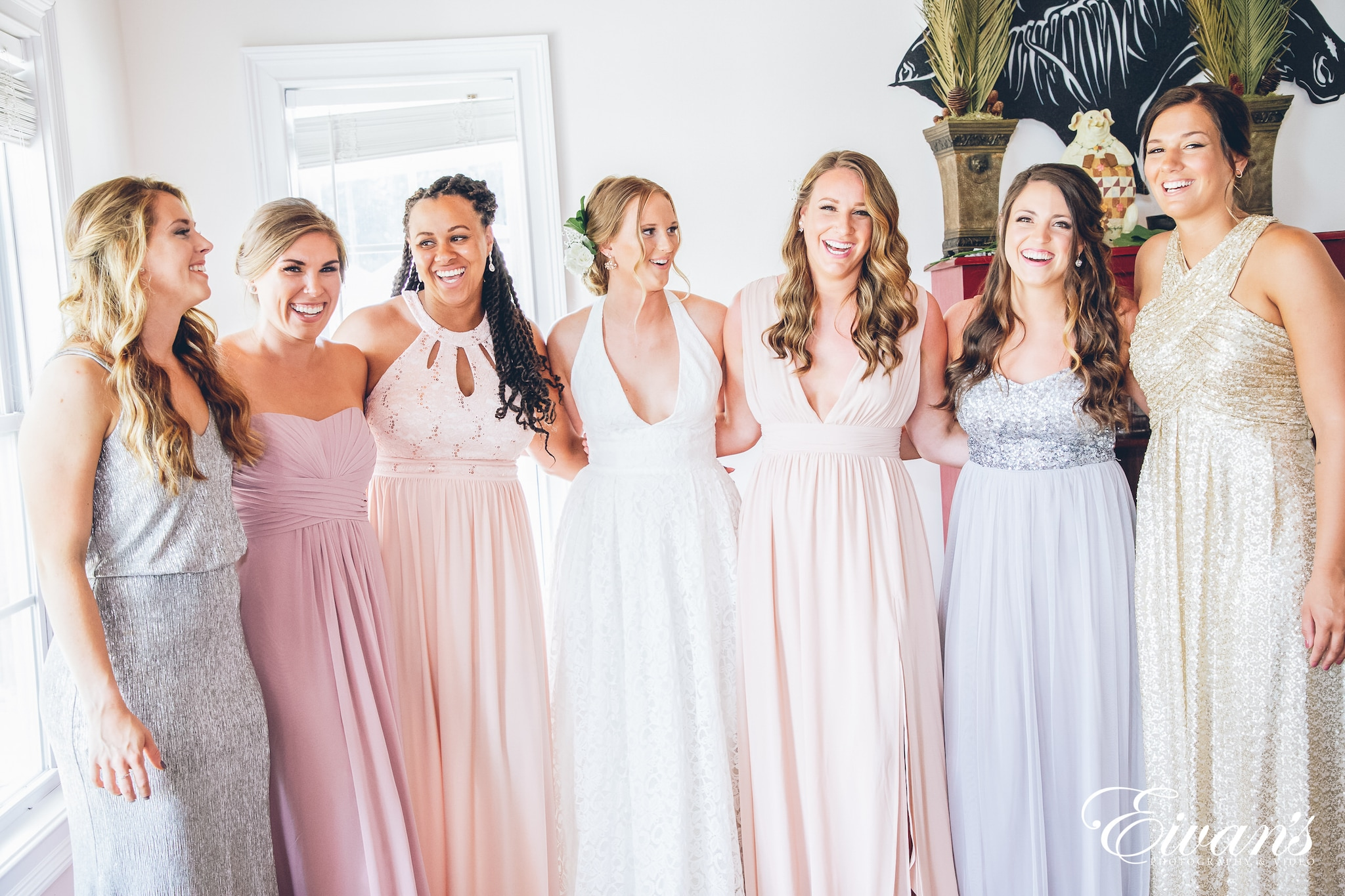 woman in a white dress with her bridesmaids