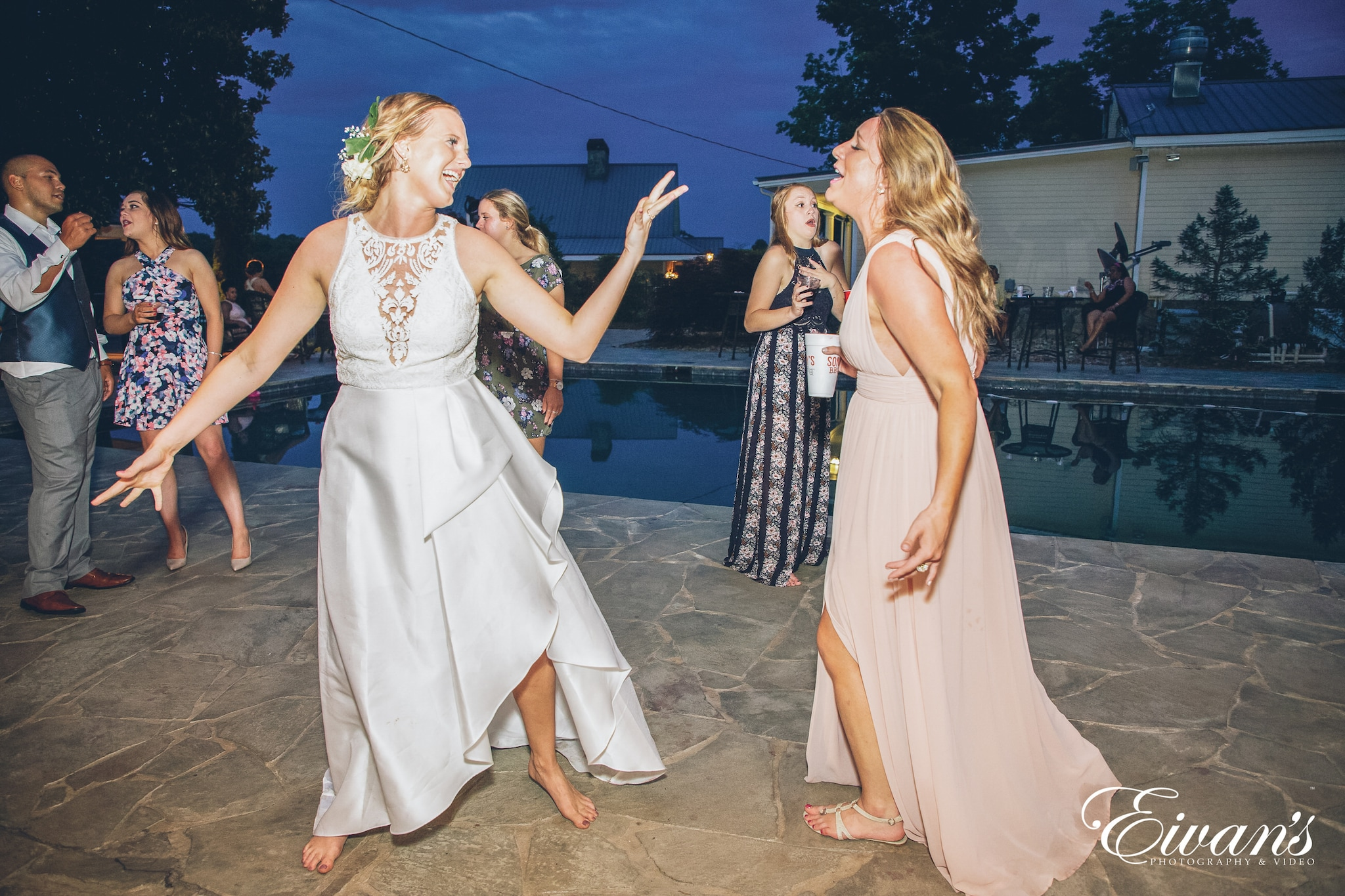 woman in a white dress and woman in a pink dress dancing