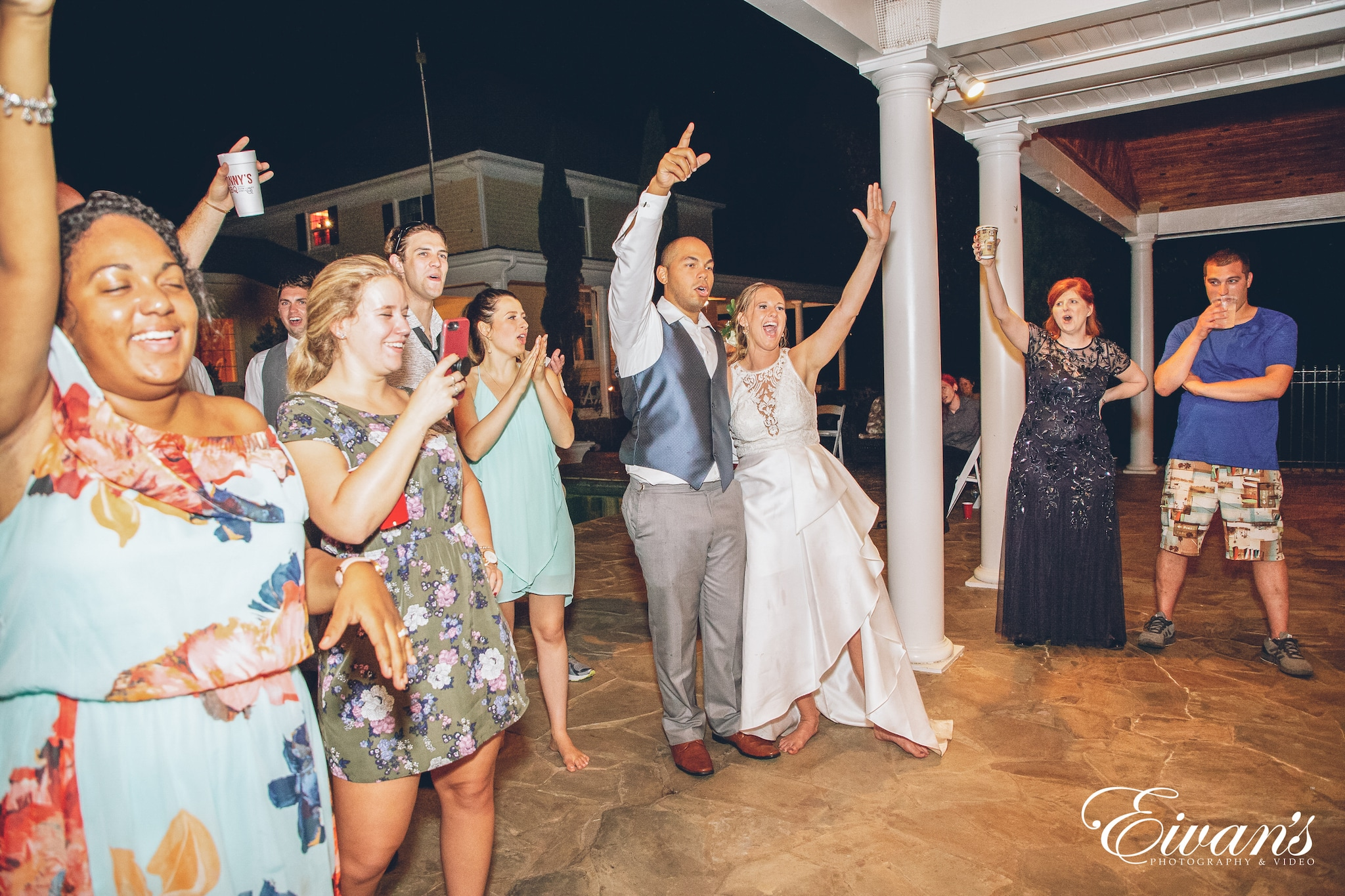 bridal party with hands in the air