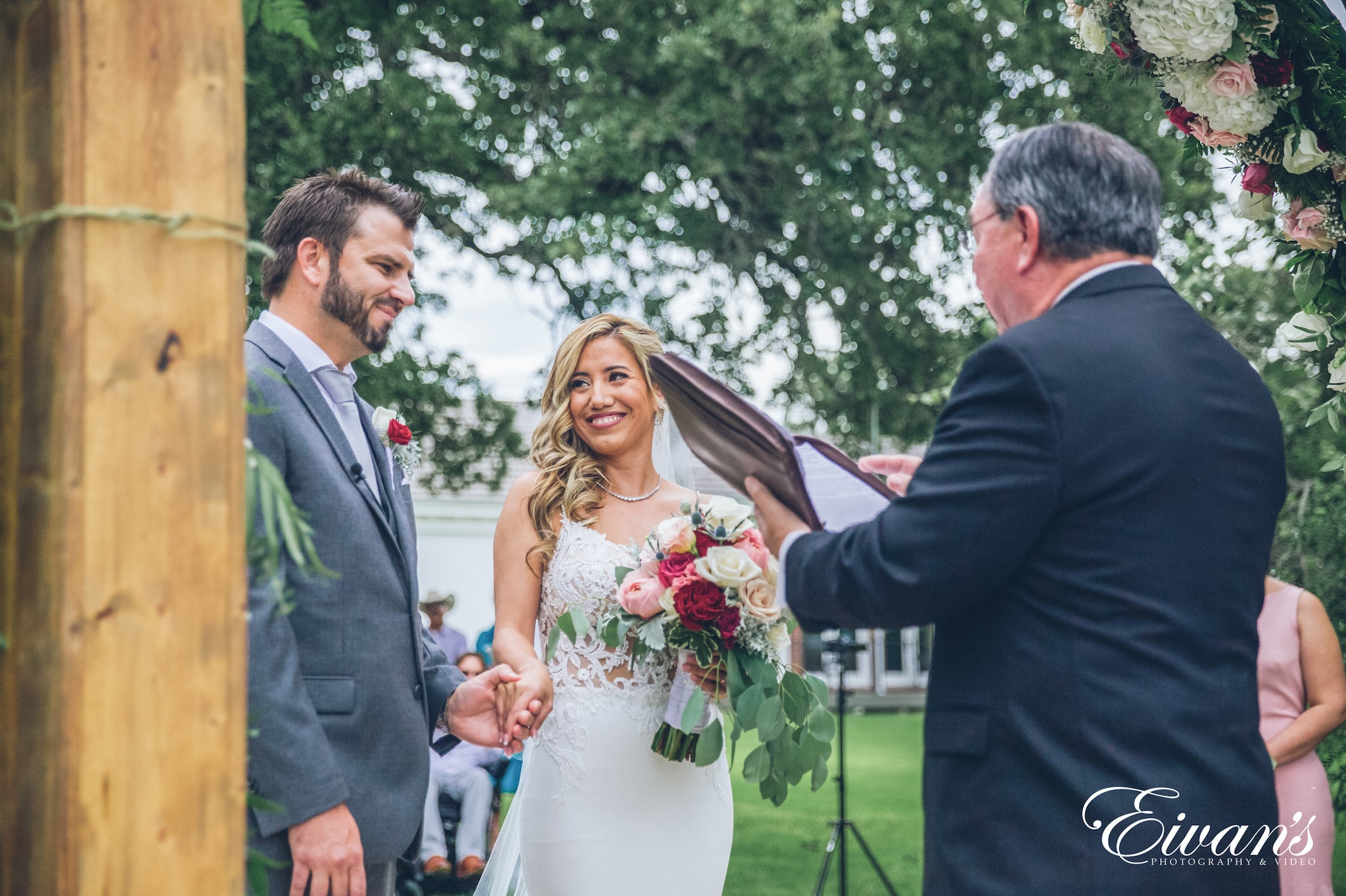 man in black suit jacket and woman in white wedding dress