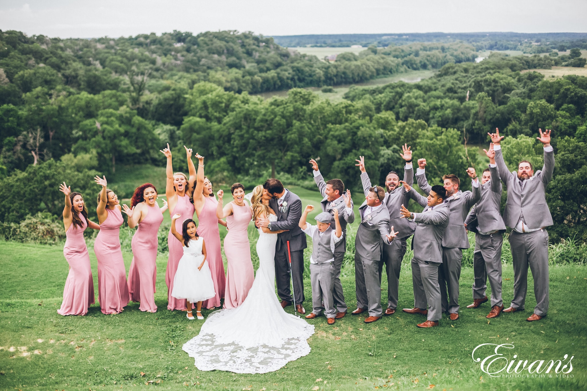 group of people in wedding dress standing on green grass field during daytime