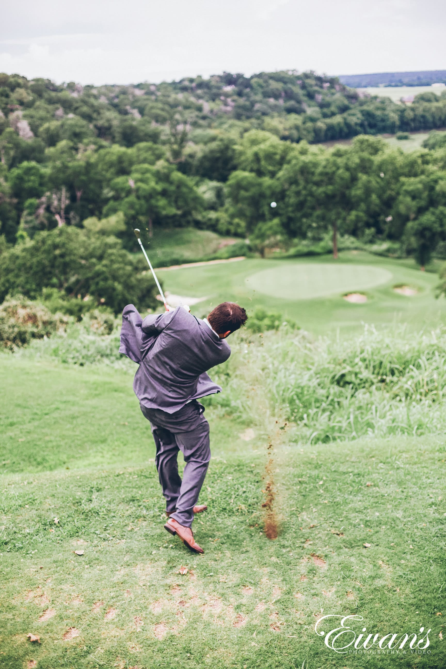 man in gray jacket and green pants playing golf during daytime