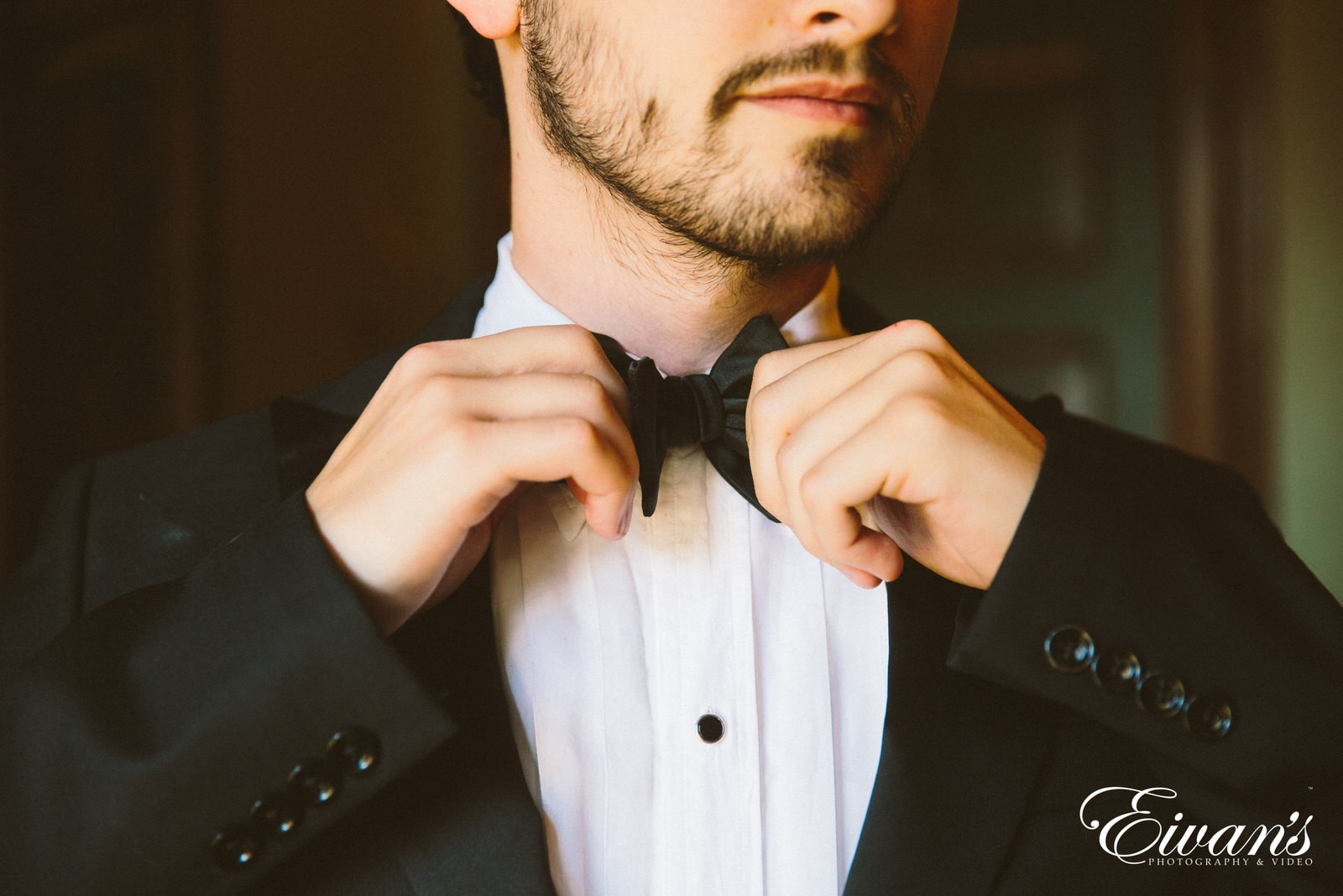 man in black and white polka dot bowtie and white dress shirt
