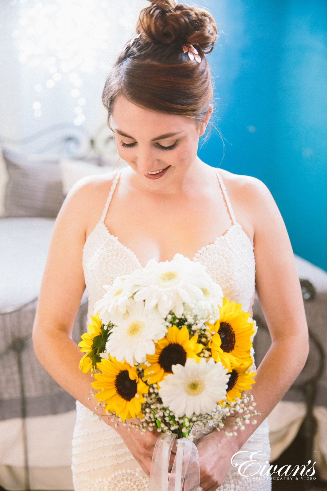 woman in white floral lace tank top holding yellow flower