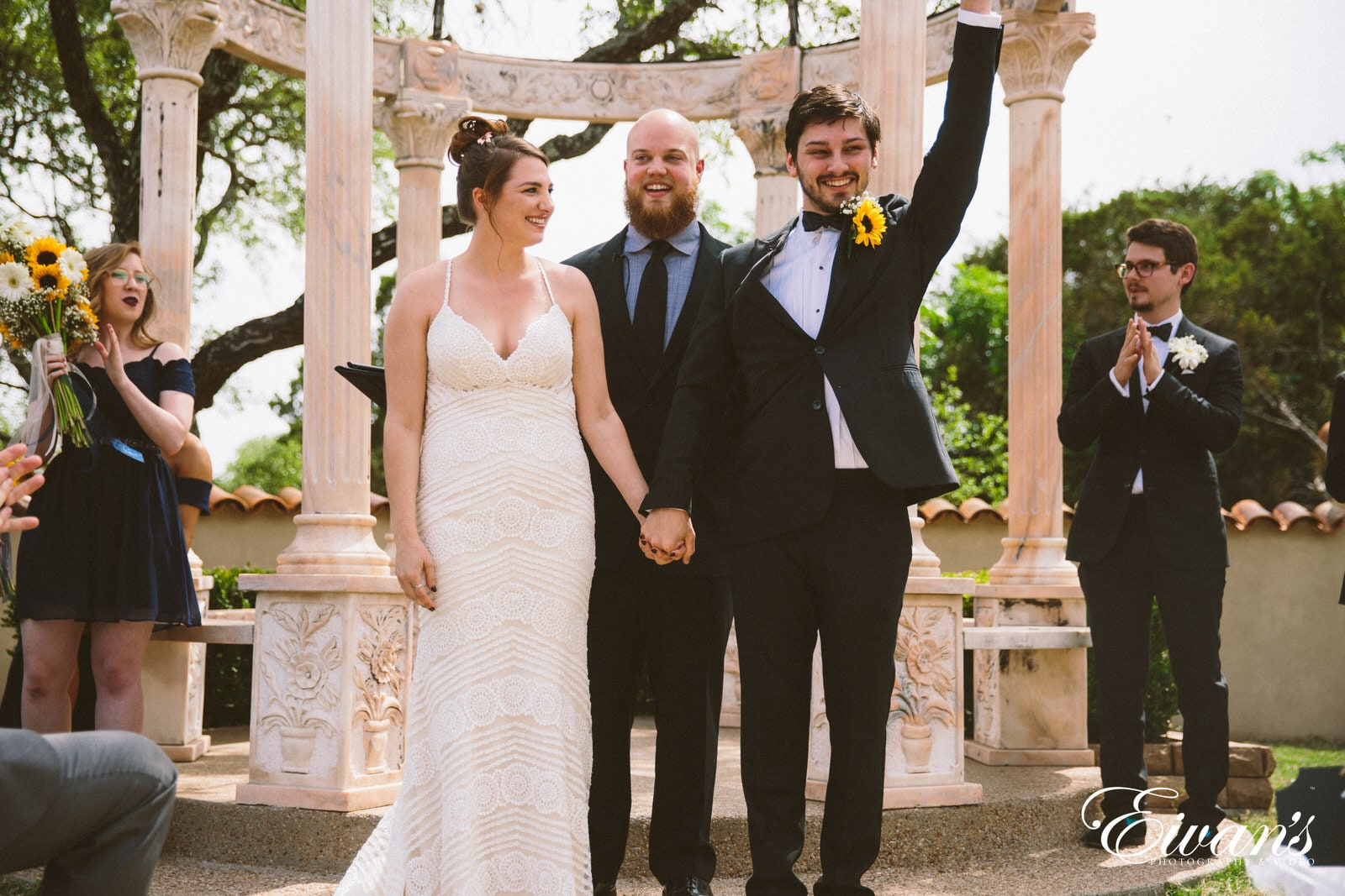 woman in white wedding dress standing beside man in black suit