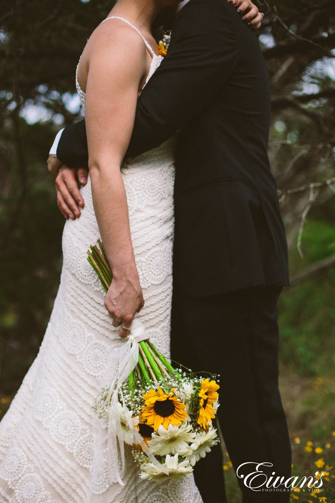 man and woman holding bouquet of flowers