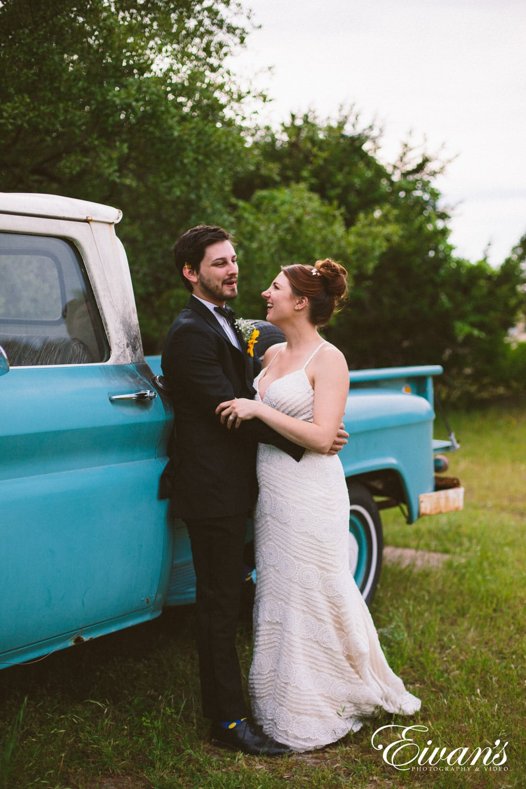 woman in white dress leaning on blue car