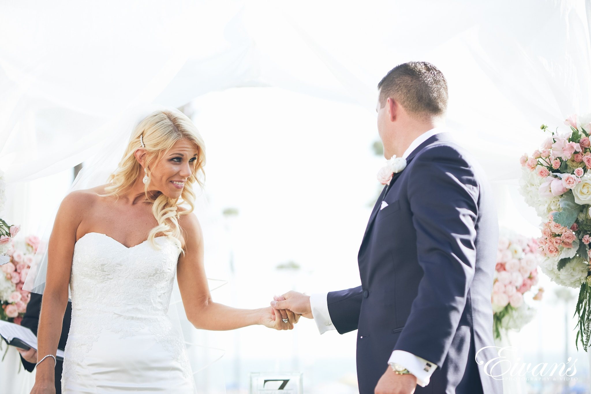 man and woman holding hands at the alter