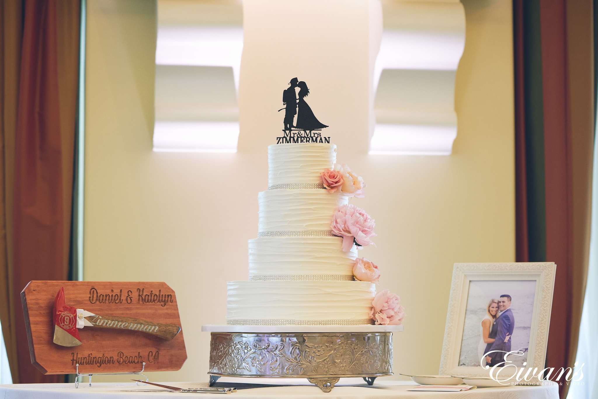 four teared wedding cake, an axe, and a picture frame