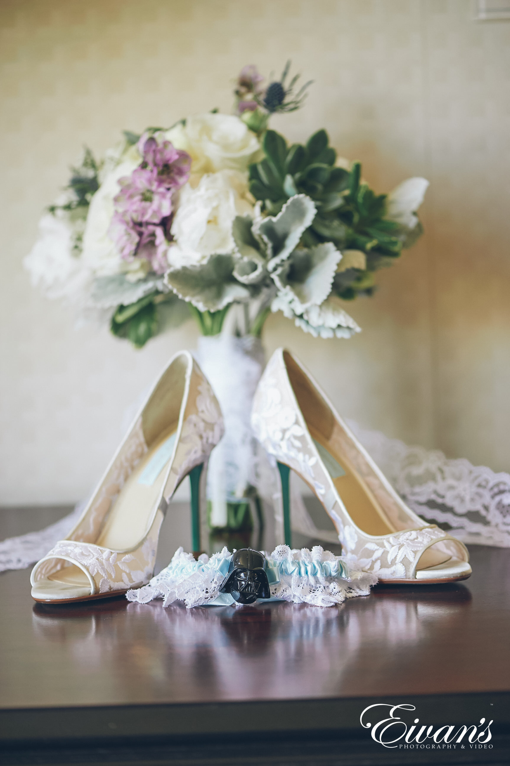 shot of a bouquet with lace shoes and garter