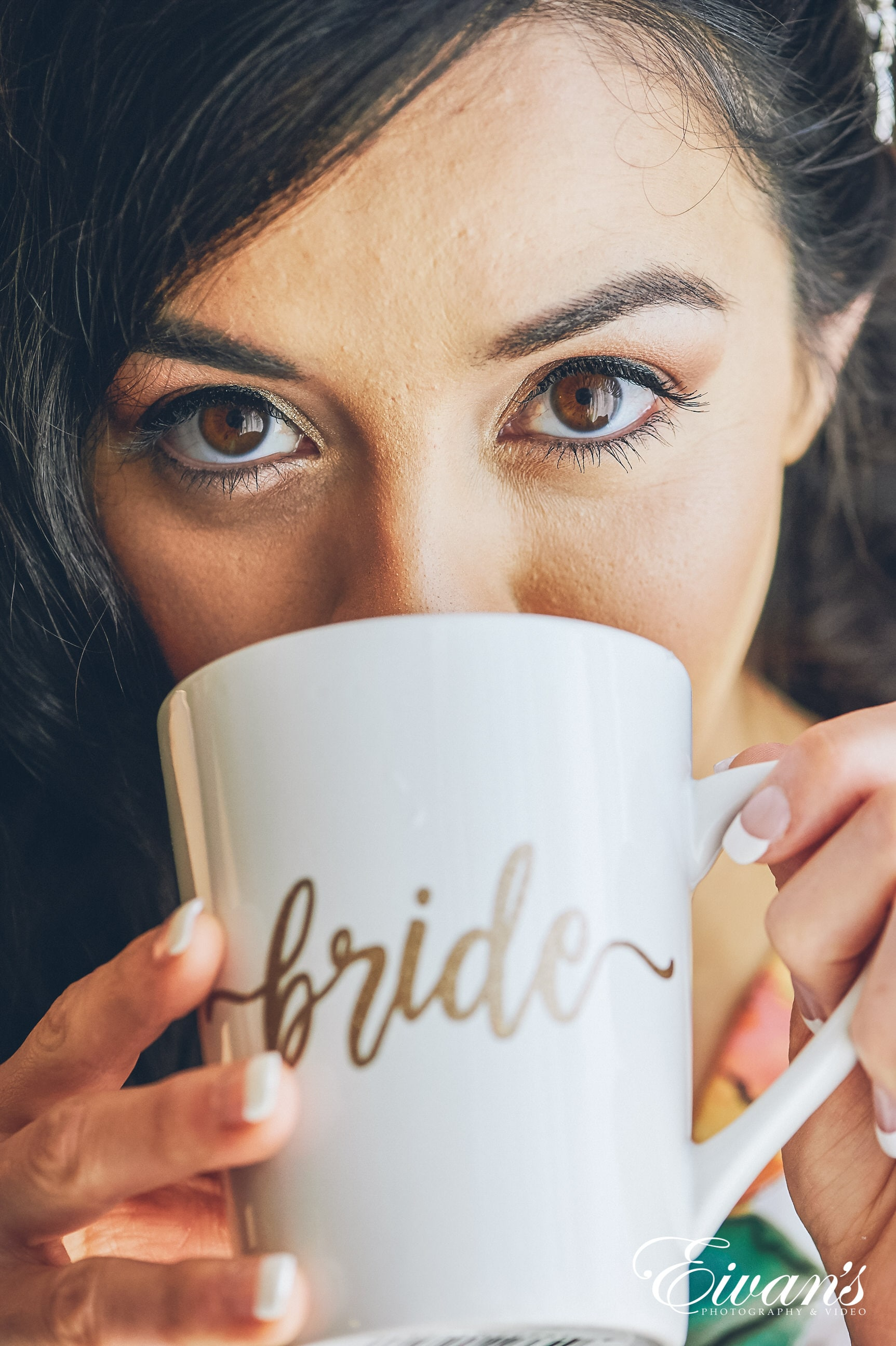 close up shot of woman with brown eyes drink out of a mug