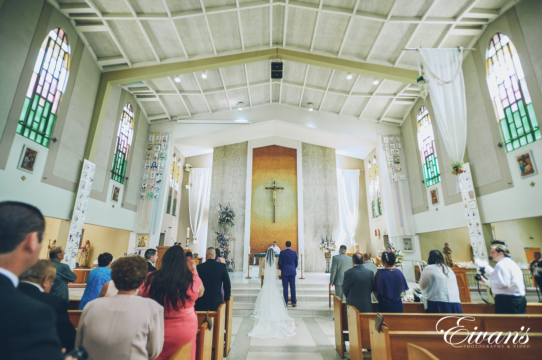 bride and groom at the alter in a church