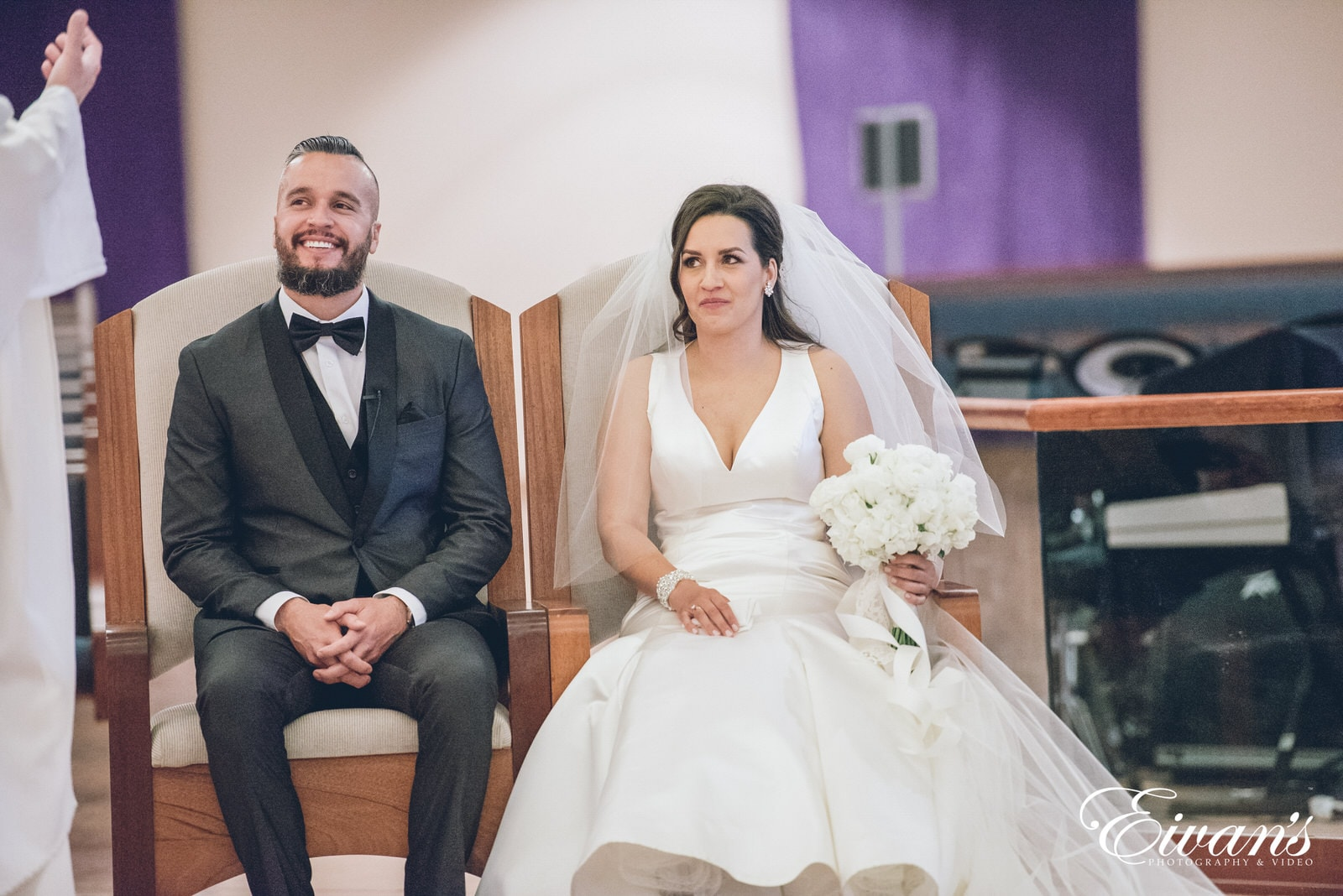 man and woman sitting in chairs
