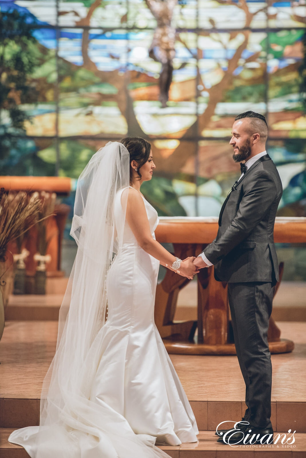 man and woman at the alter holding hands