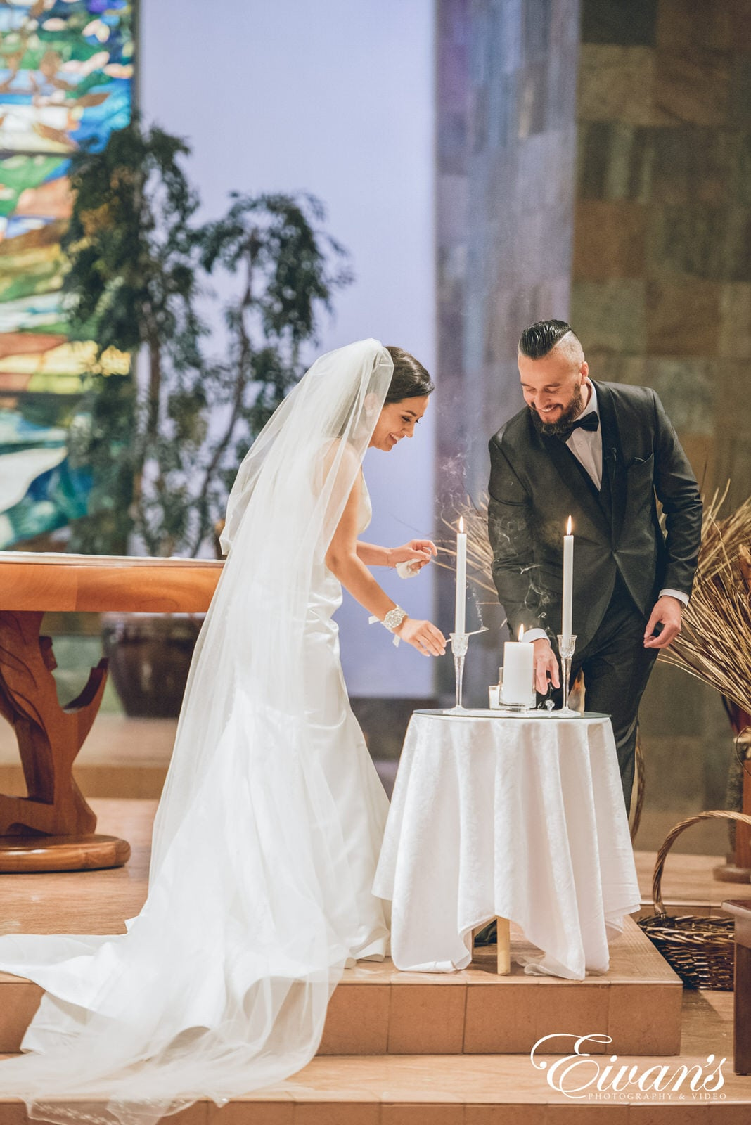 man and woman lighting a candle