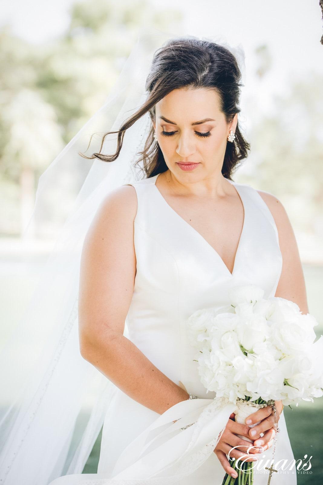 portrait of a woman in a long white dress