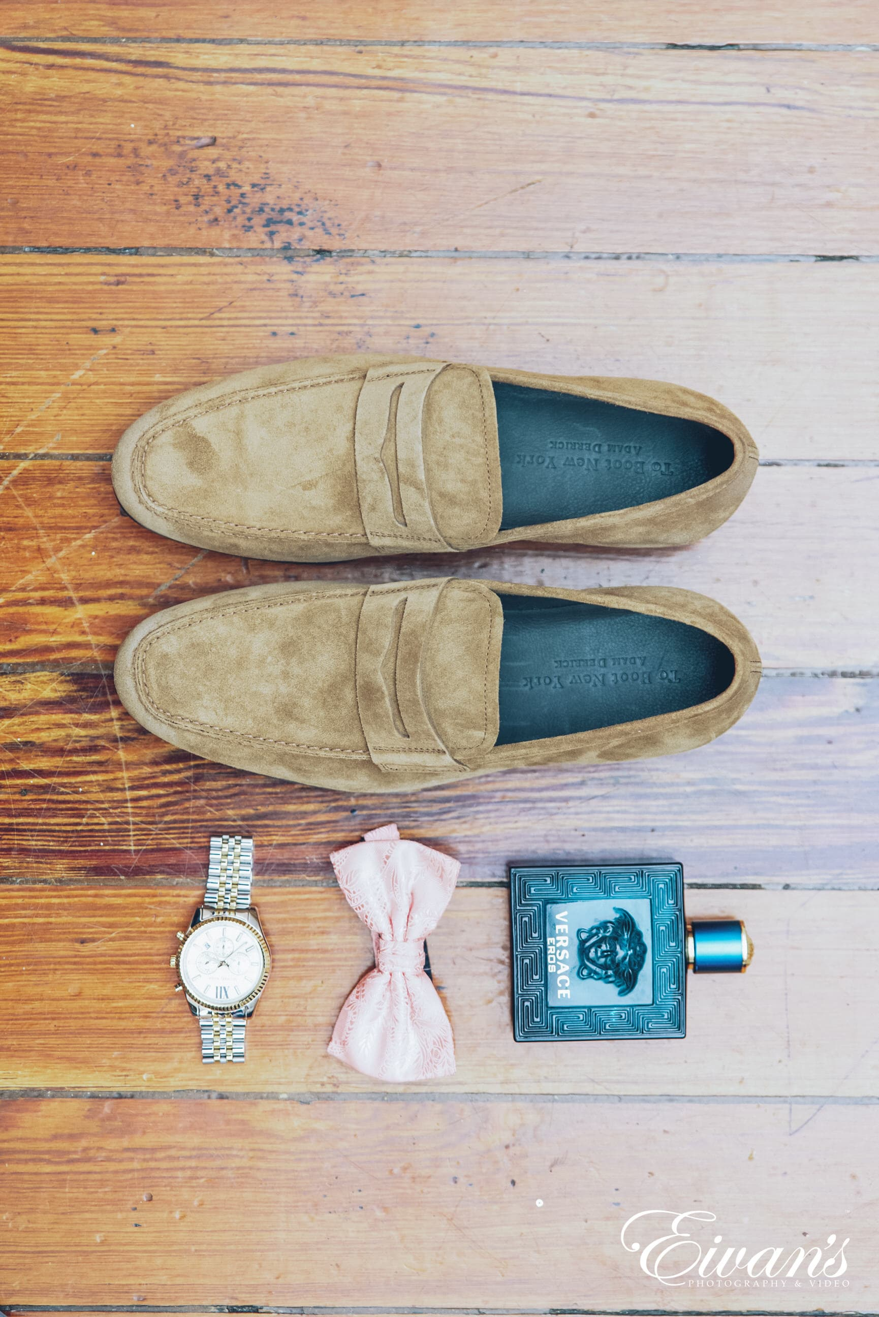 brown leather slip on shoes beside black and orange disposable lighter