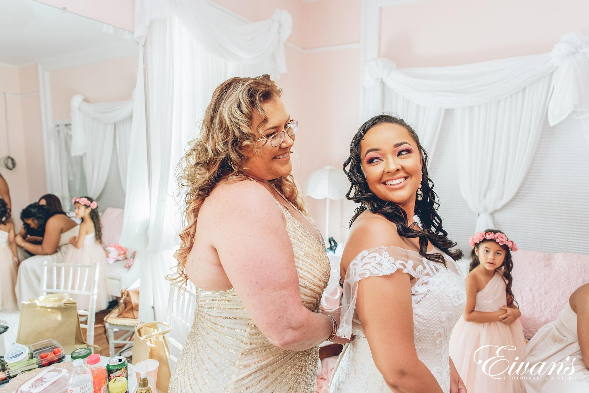 2 women in white tank top smiling