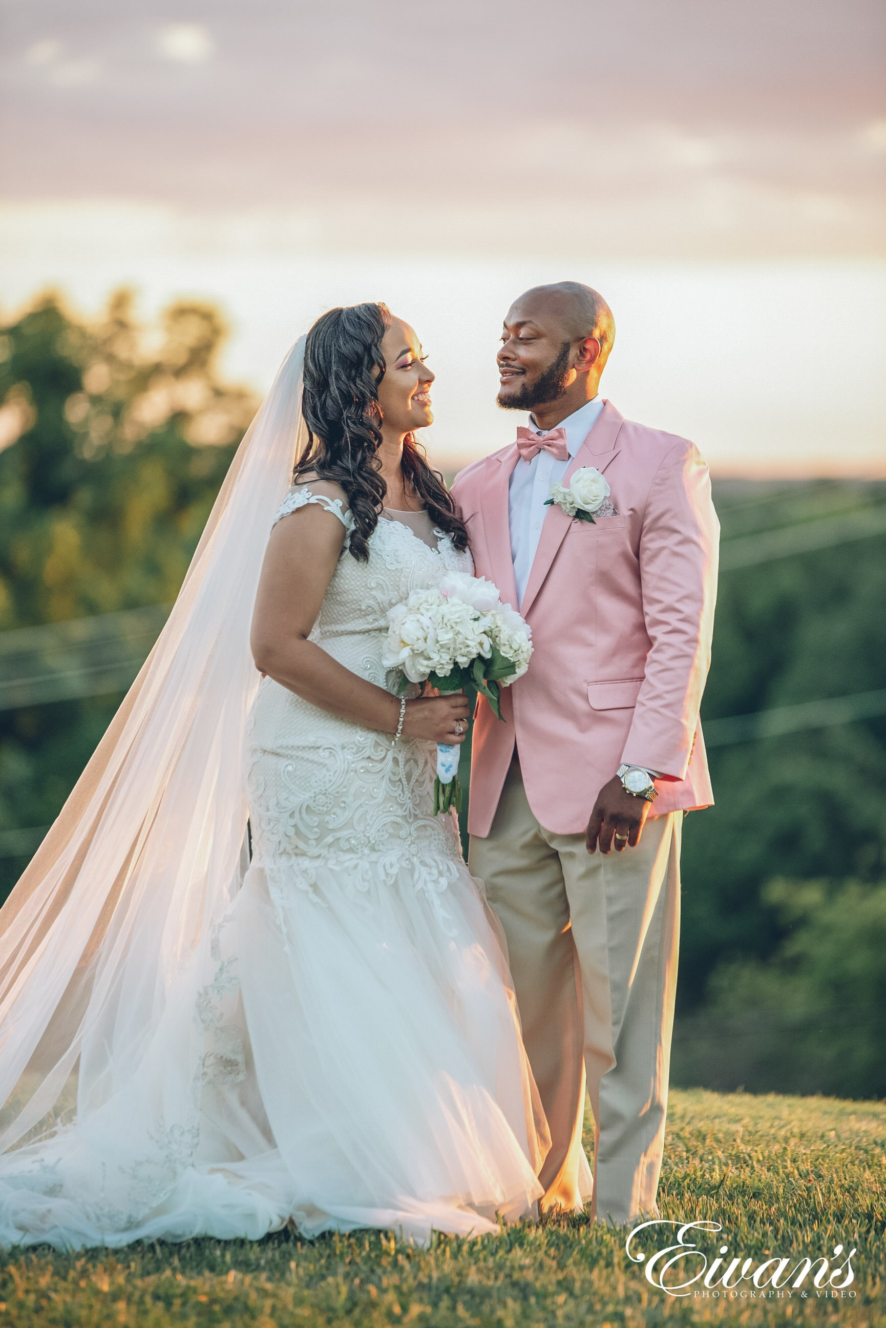 man in brown suit and woman in white wedding dress