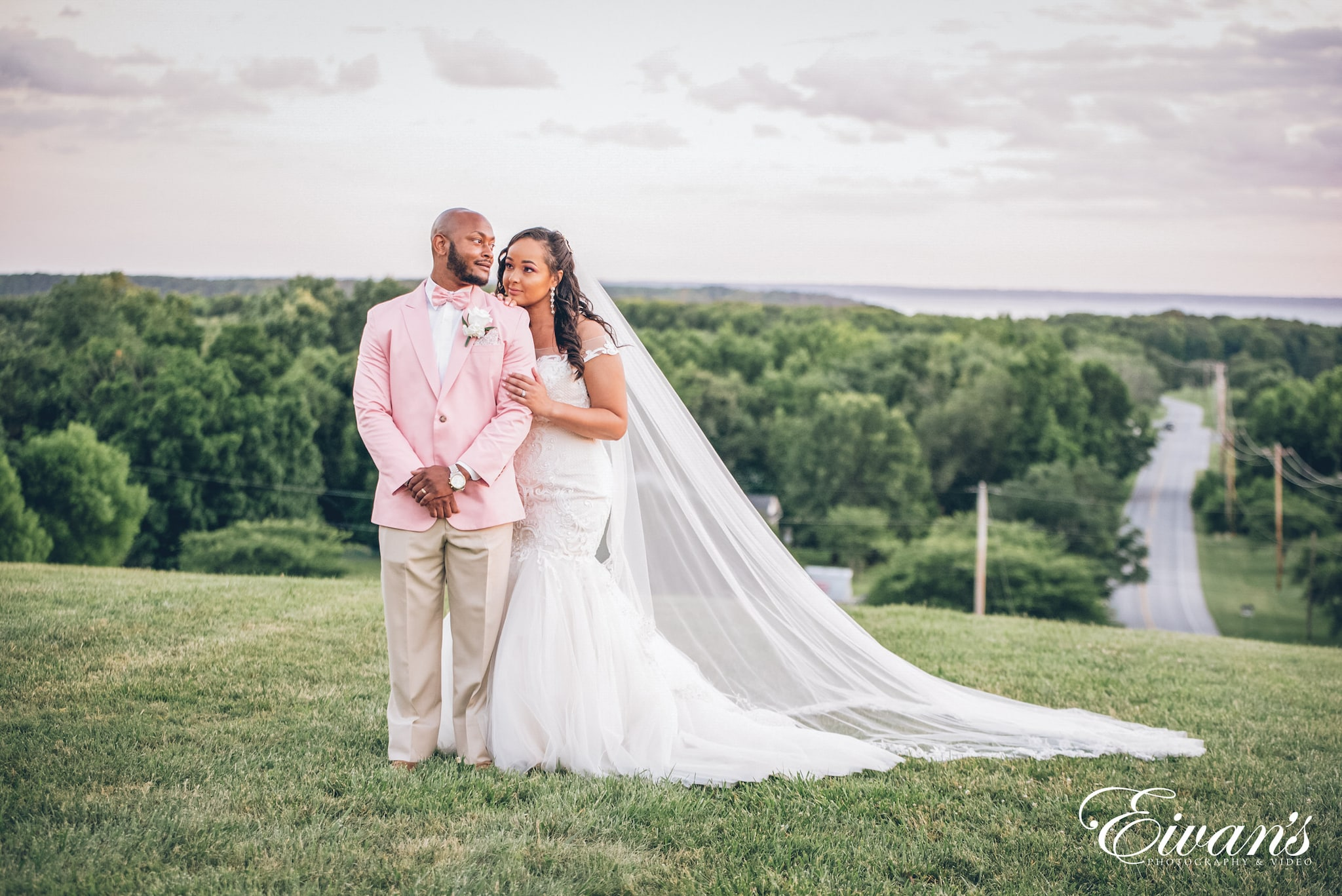 man in pink suit and woman in white dress
