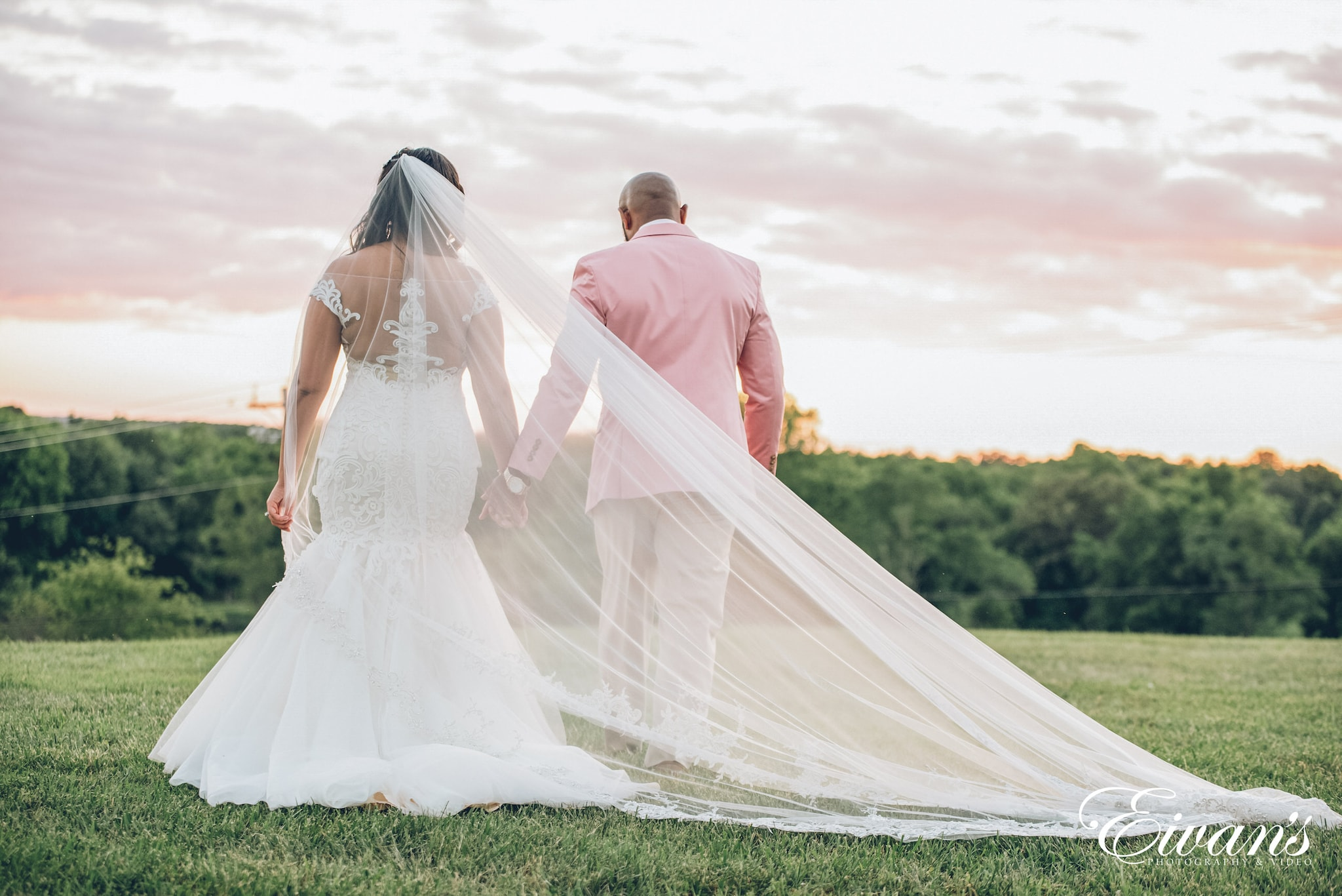 man and woman in wedding dress walking on green grass field during daytime
