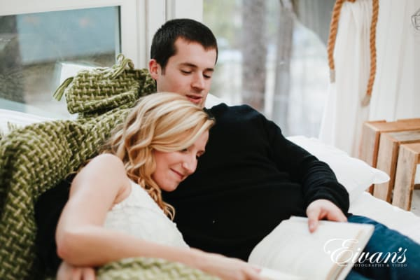 couple at home, sitting comfortable, during engagement photoshoot